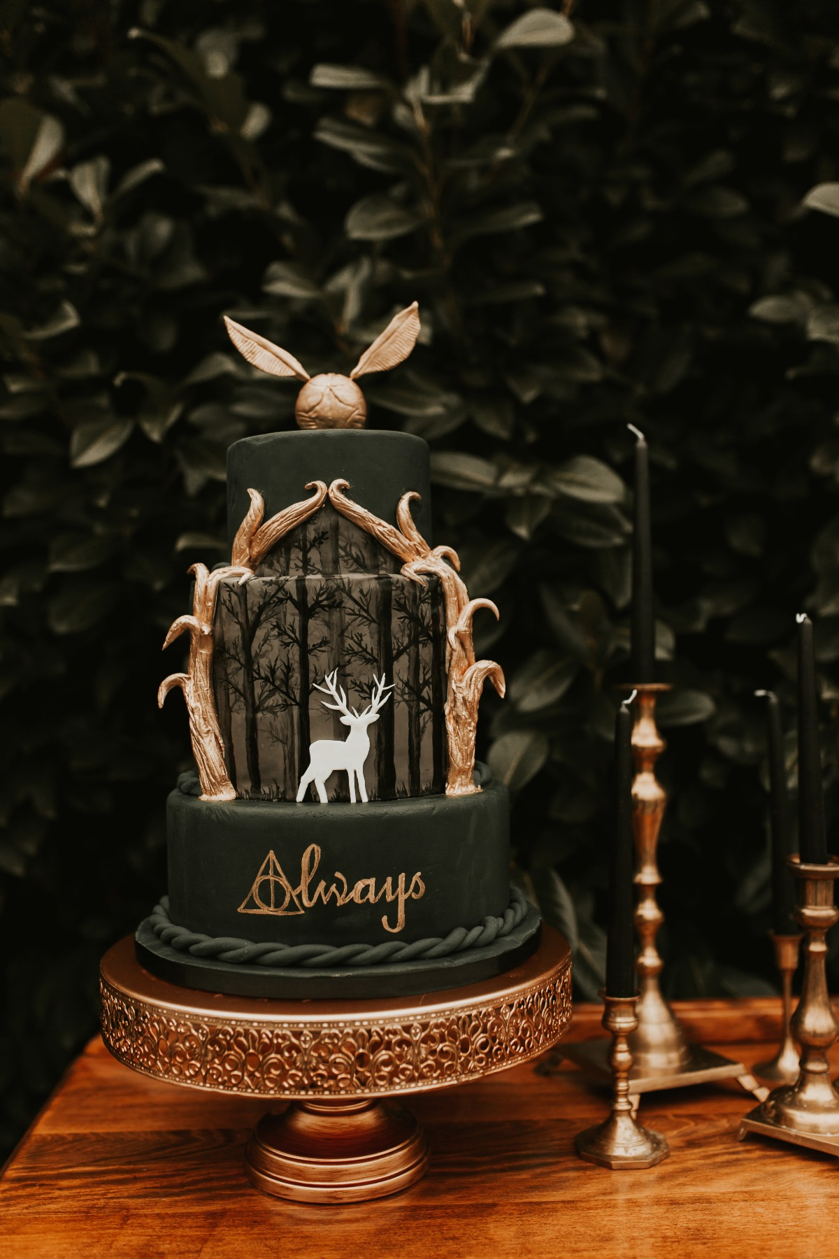moody forest green Harry Potter themed wedding cake