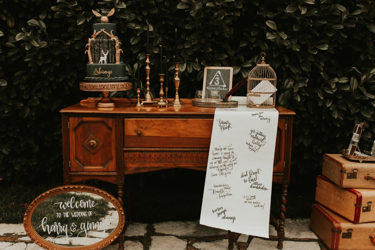 moody forest green and gold Harry Potter themed cake table