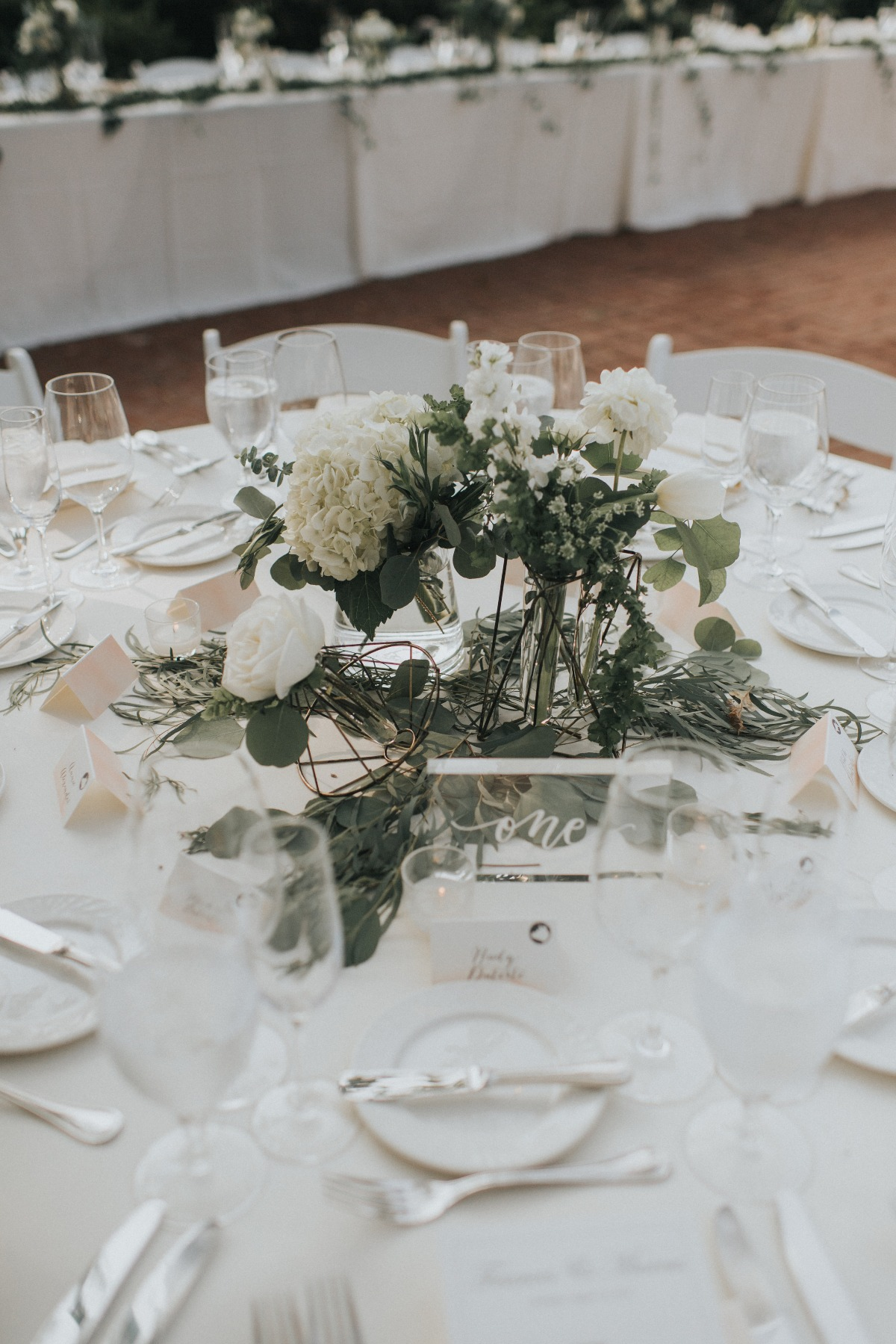 white and greenery wedding centerpiece