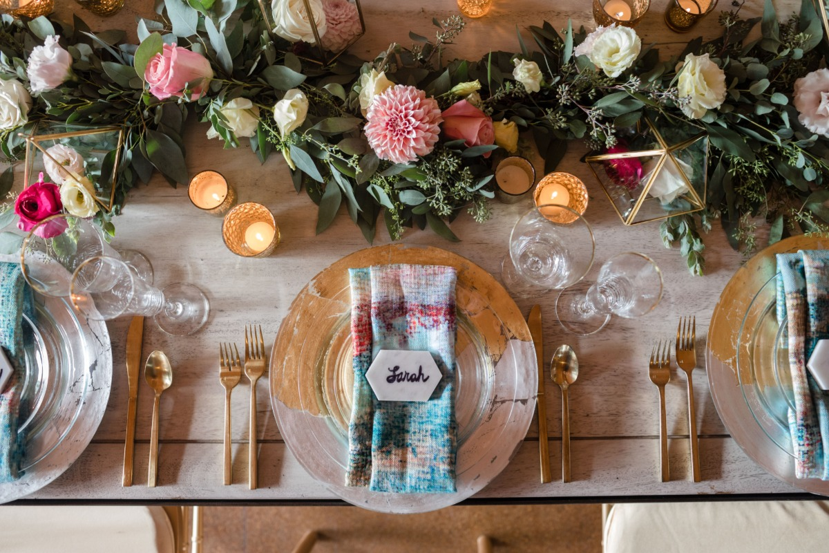 fun and funky gold and silver and blue and pink wedding table idea