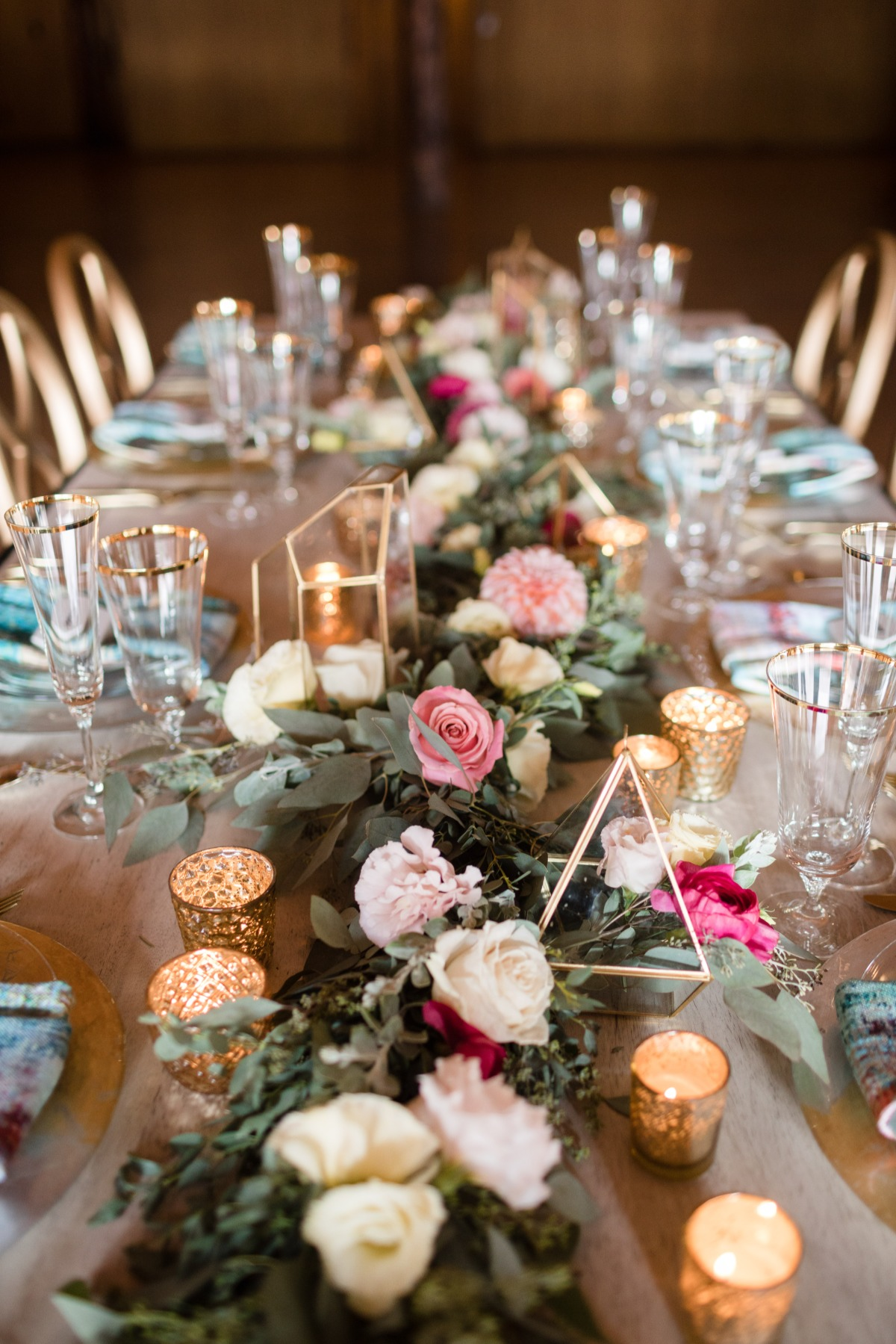 fun and funky wedding table with floral garland