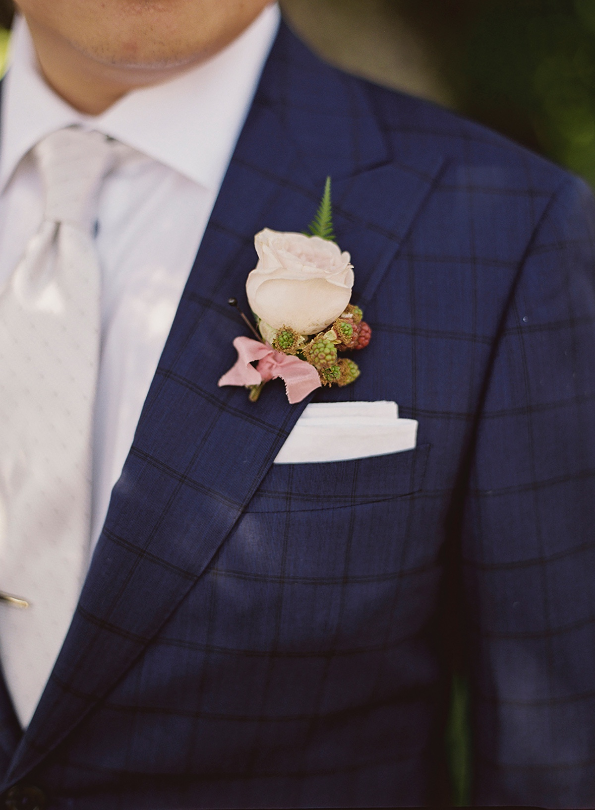 Checkered suit and boutonniere
