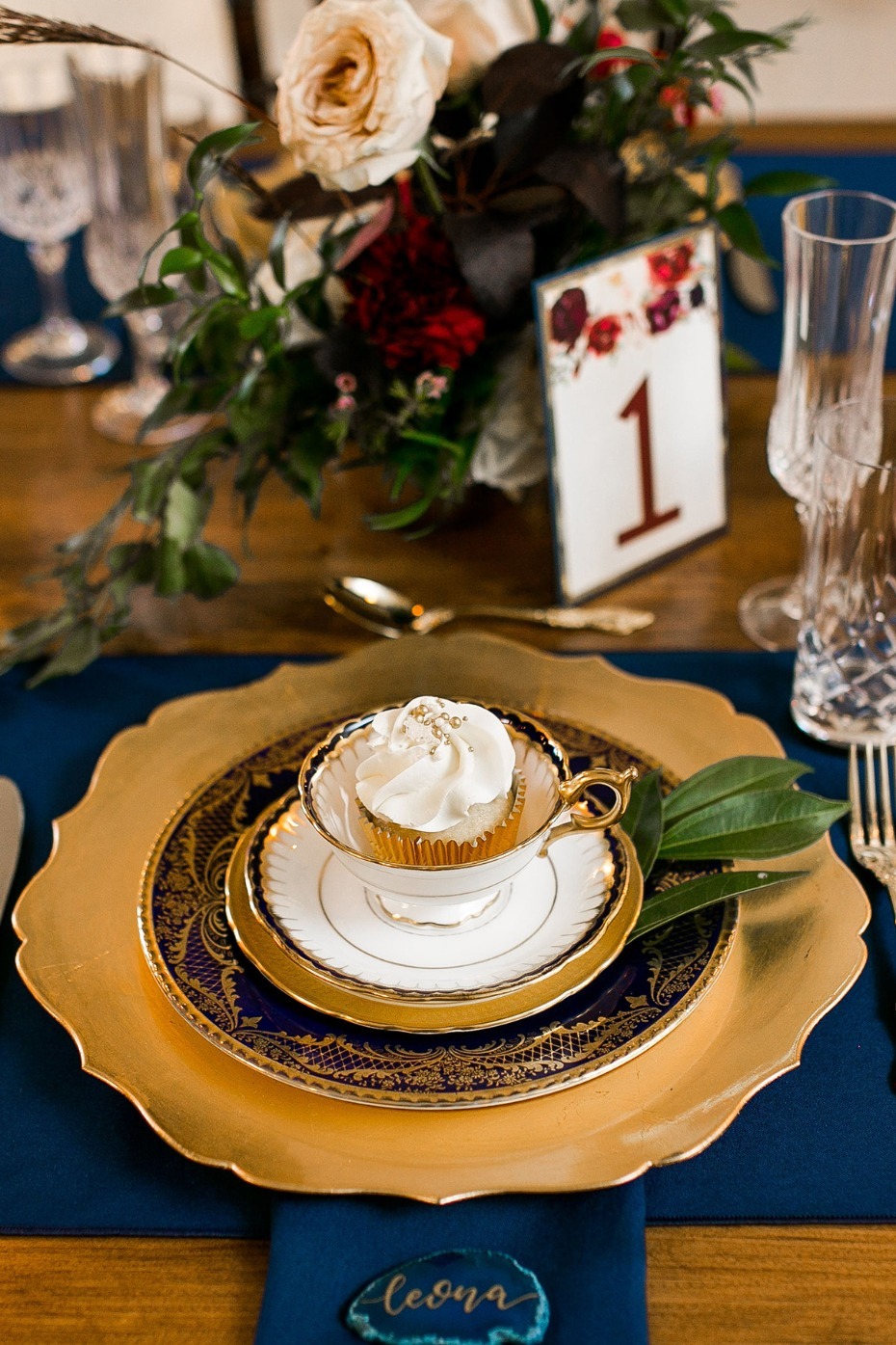 fantasy wedding place setting in blue and gold