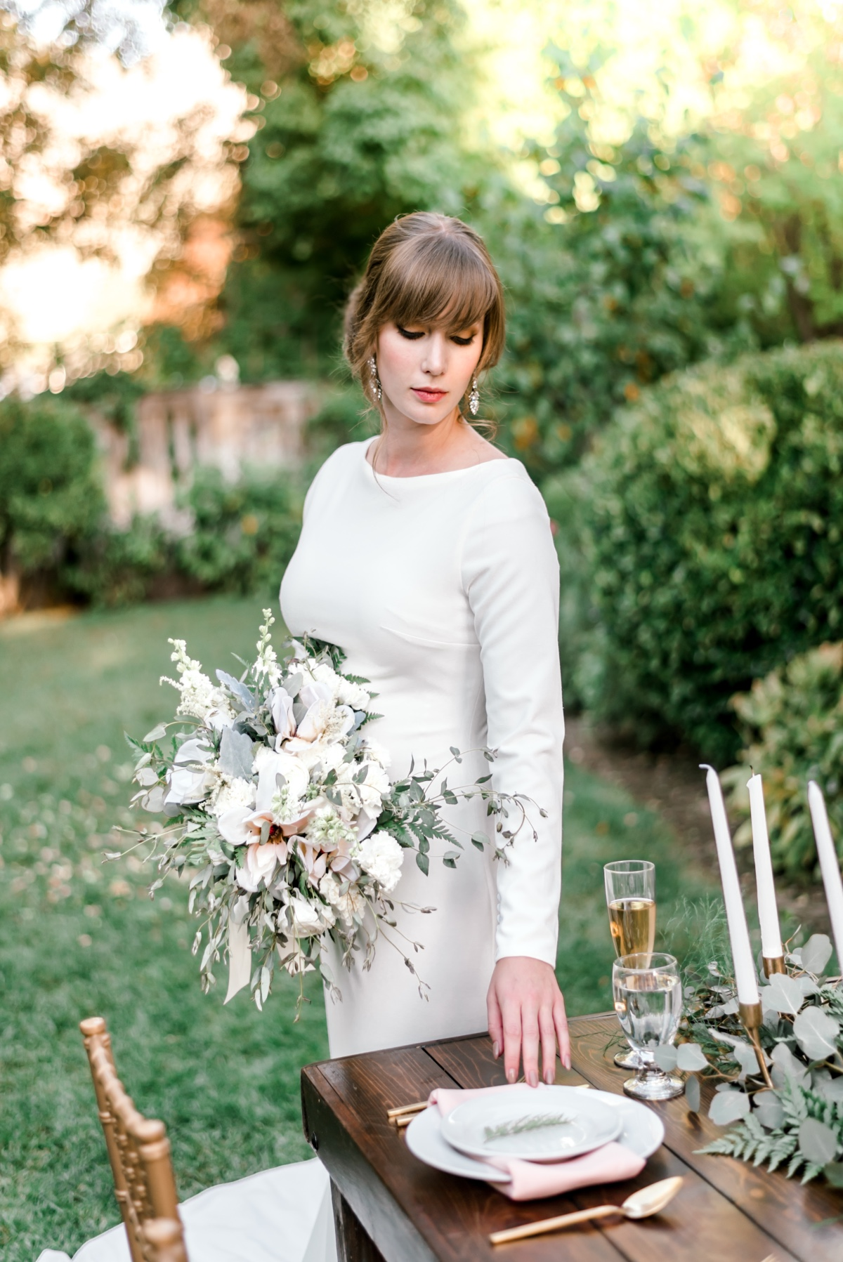 bride in modern long sleeve wedding dress