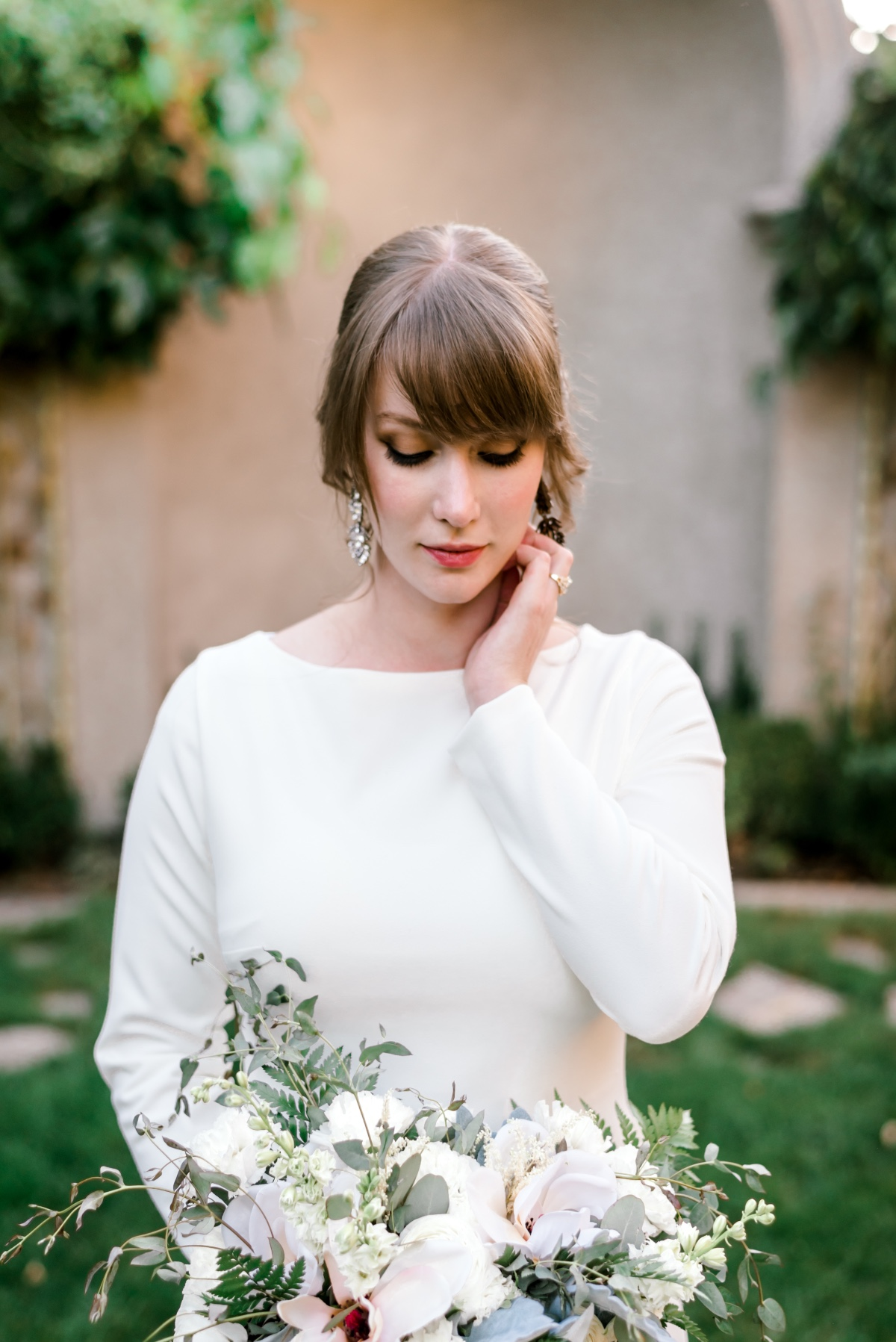 long sleeve wedding dress and metallic wedding makeup