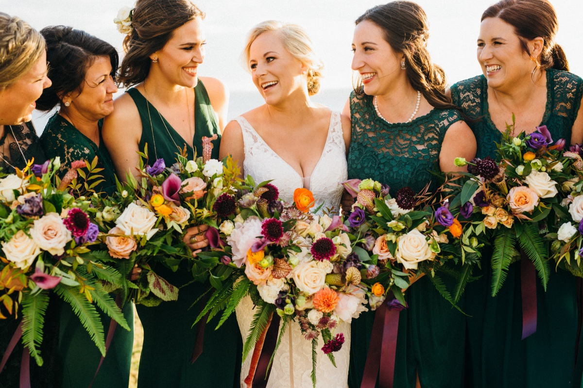 Bridesmaids in emerald lace dresses