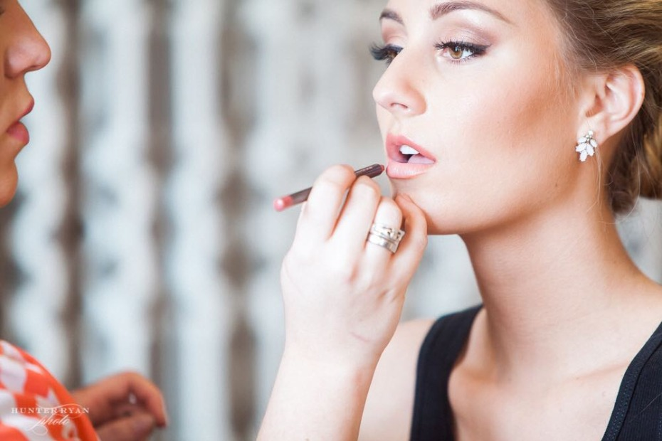 Wedding guest getting her makeup done