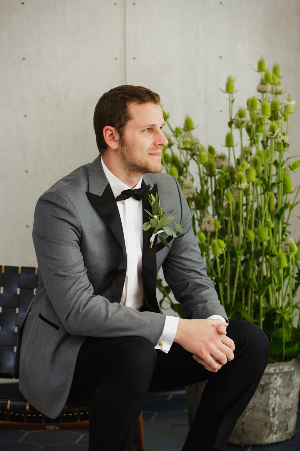 groom in grey and black suit jacket