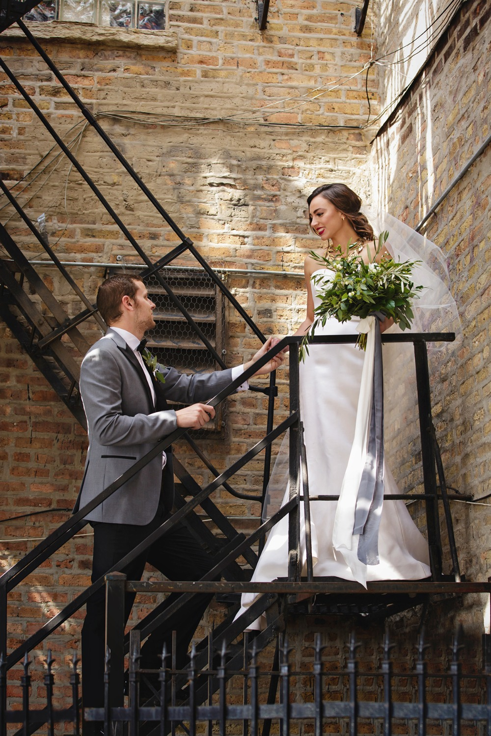 sweet fire escape wedding portrait idea