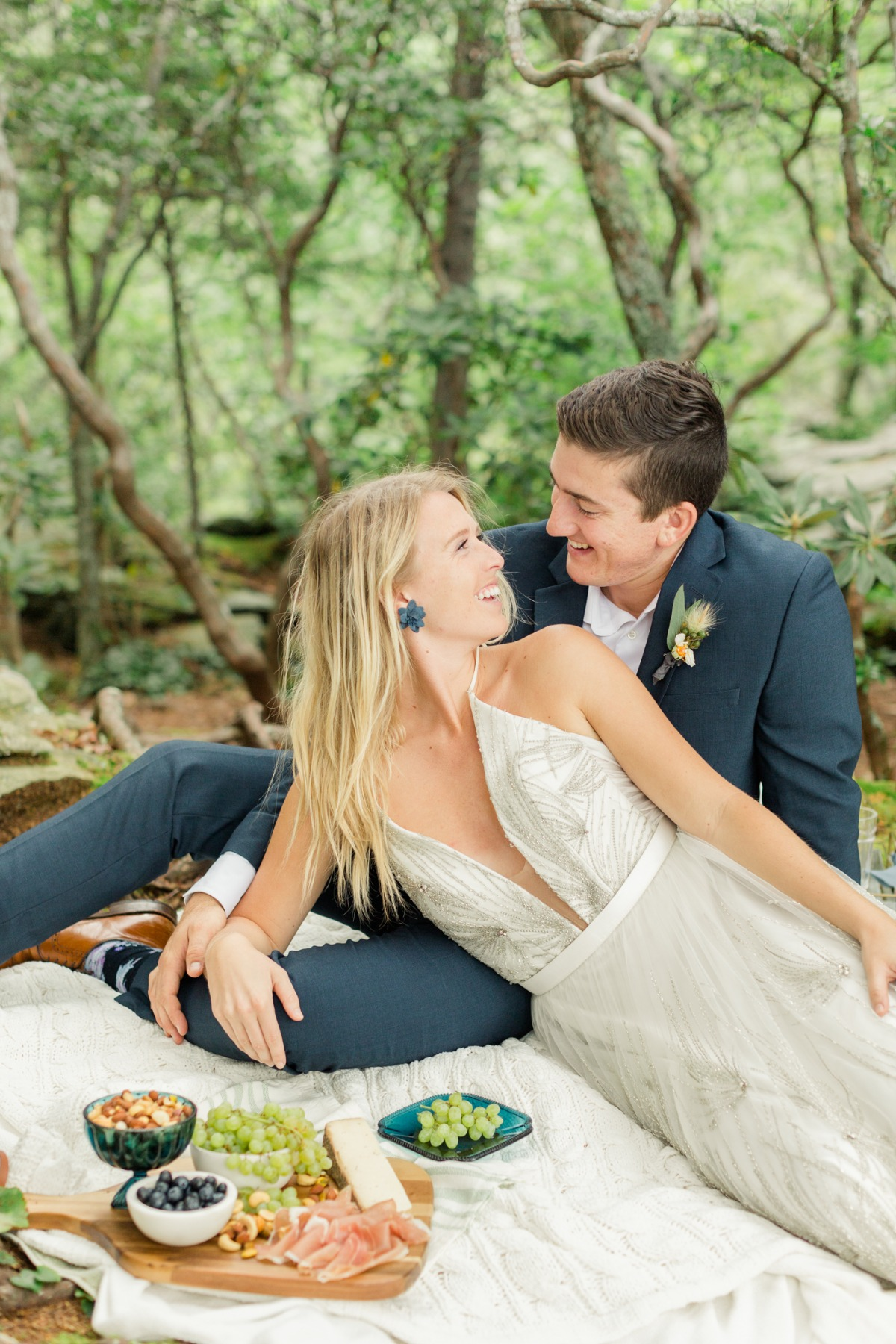 wedding couple at a forest picnic