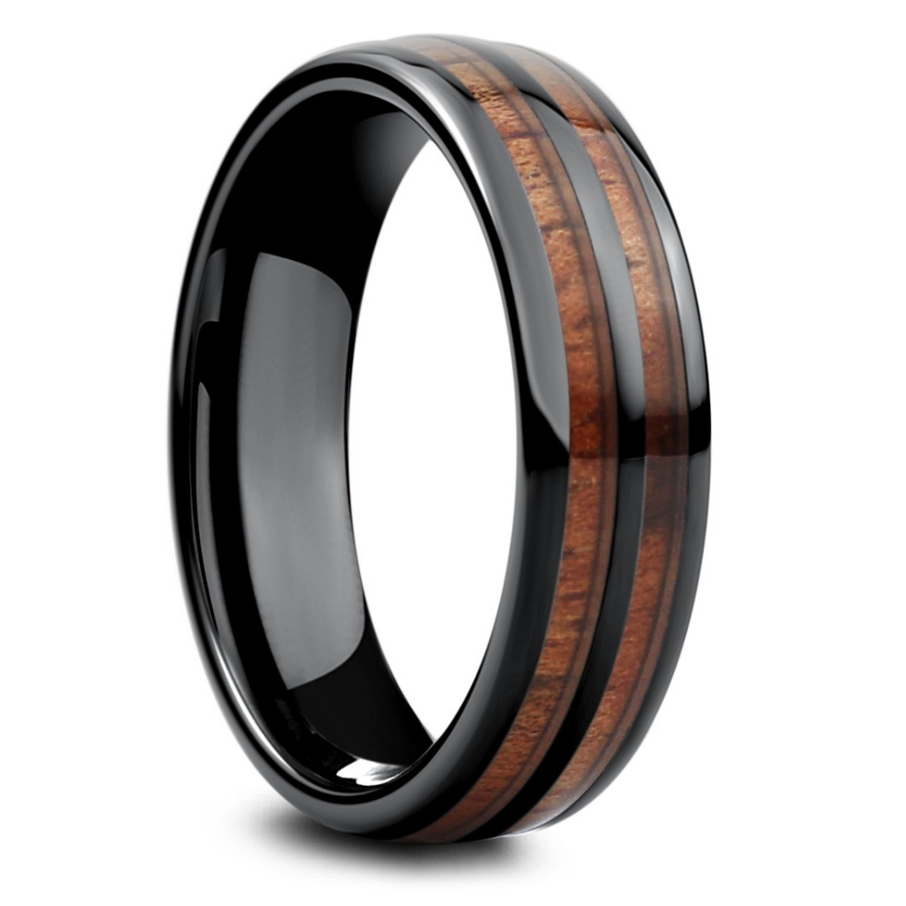 The black vintage wood barrel ring. This men's wood wedding ring is crafted out of ceramic and inlaid with natural koa wood. A wood