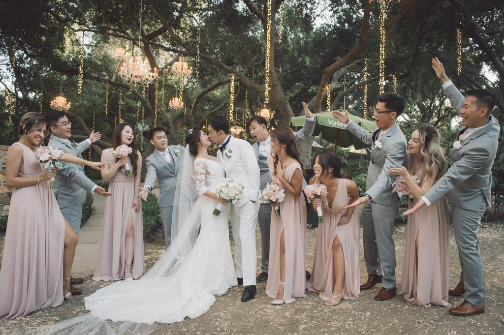 This picture of the bride and groom with their wedding entourage is nothing short of perfection! It's perfectly dreamy, romantic, and