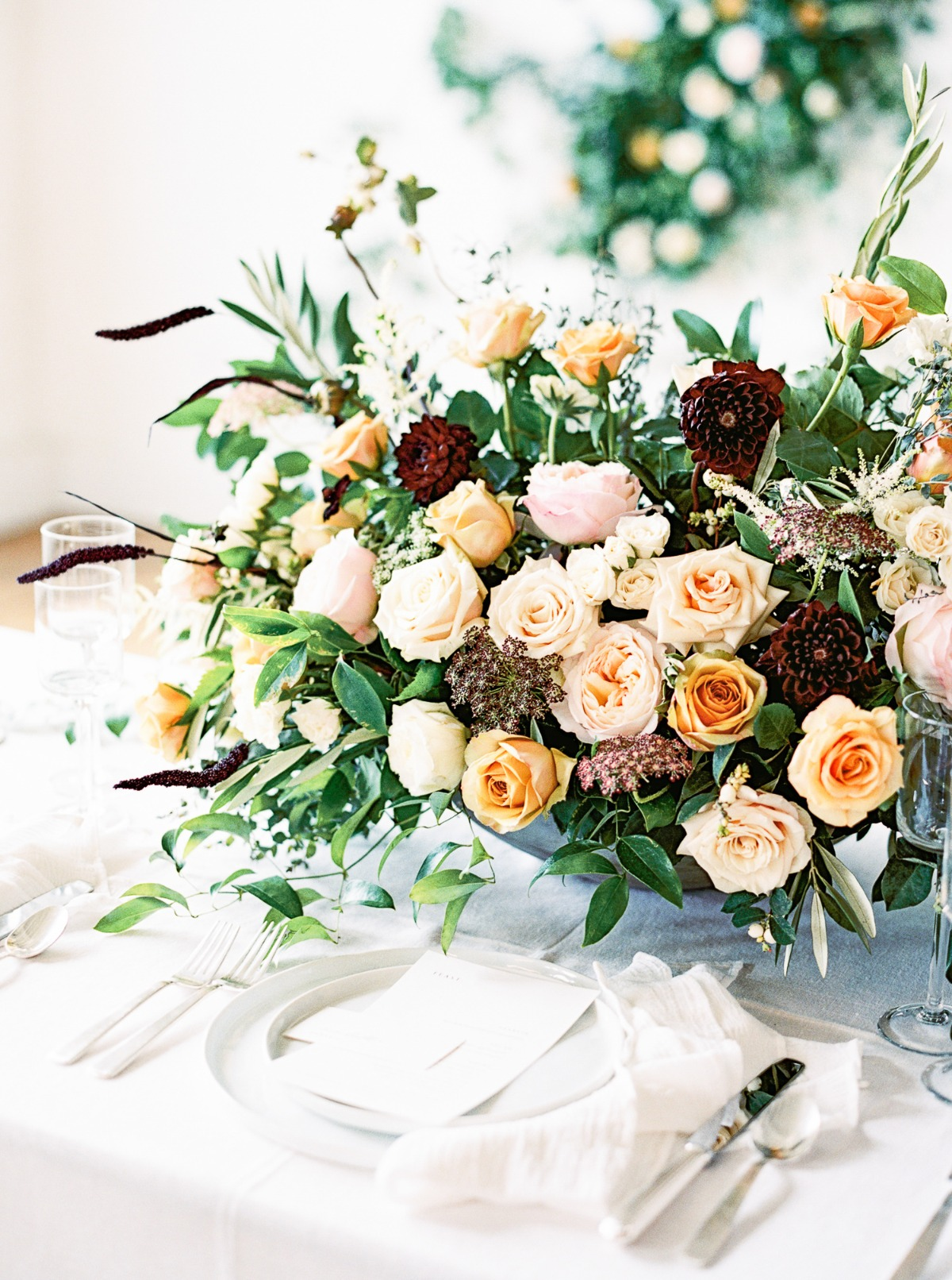 ivory yellow blush and burgundy floral centerpiece