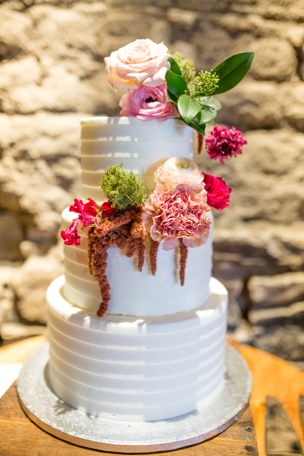 Three tier wedding cake with florals