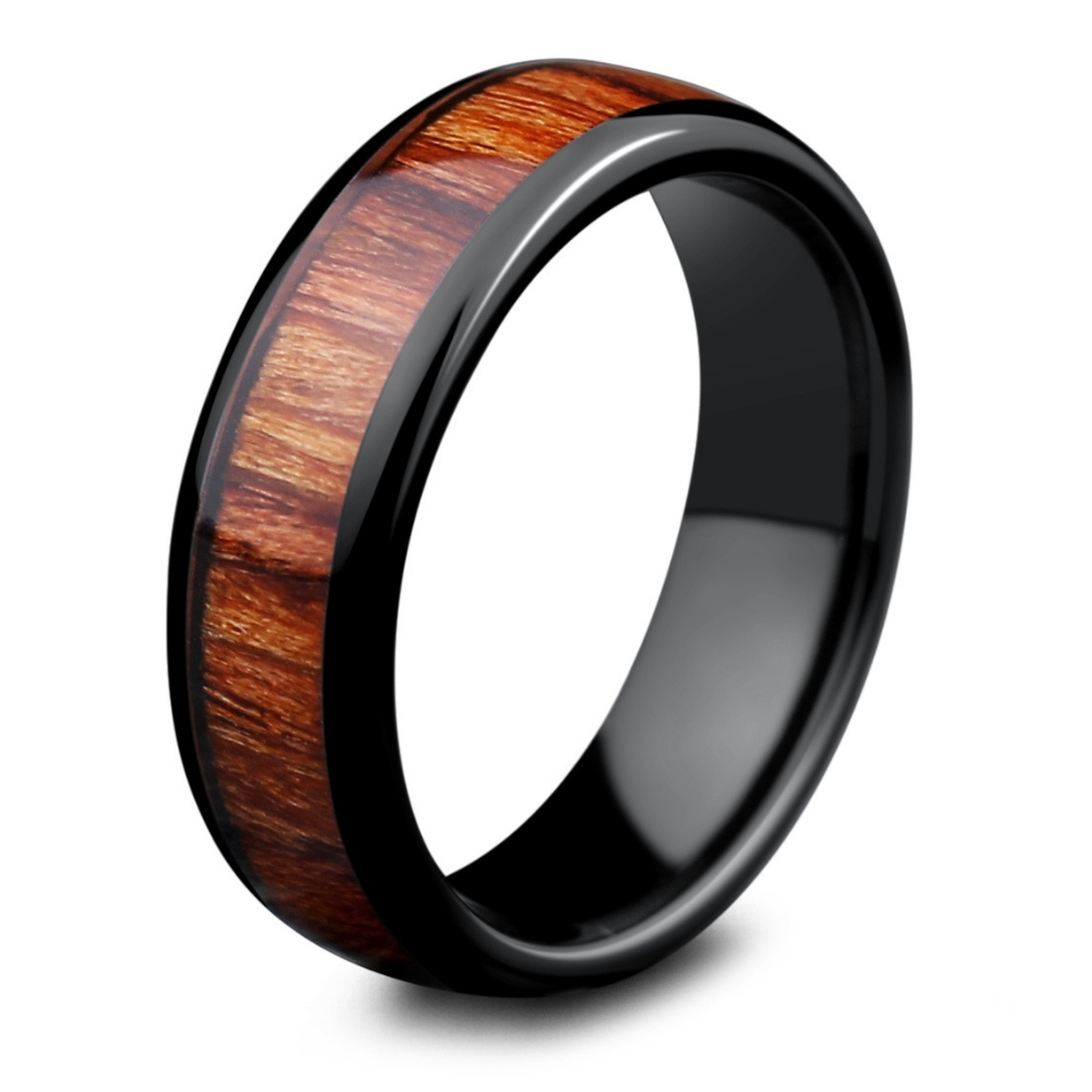 The Classic Black Wood Wedding Ring. This wood wedding ring is crafted out of black ceramic and inlaid with natural koa wood. Extremely