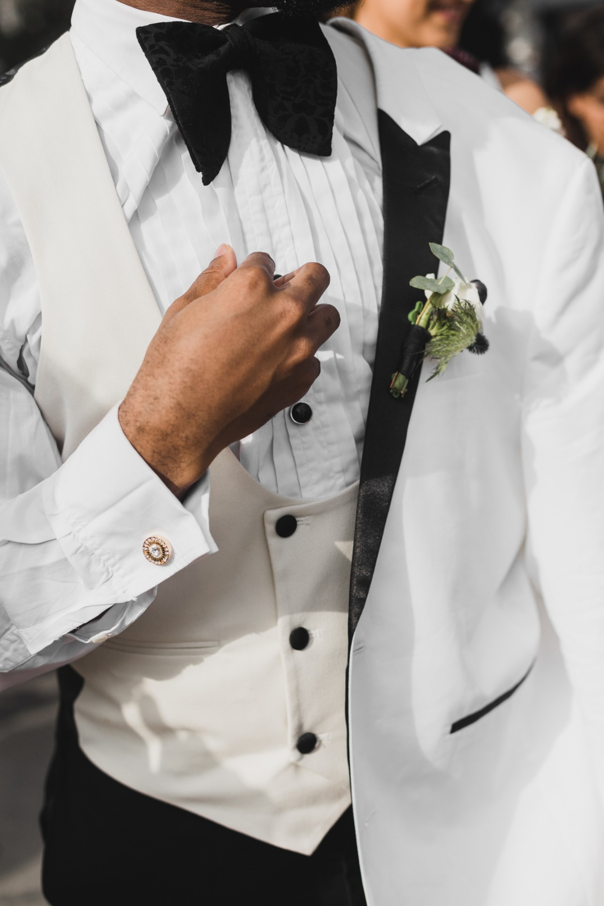 white jackets and vest groom look