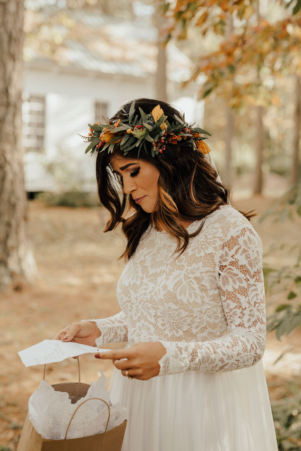 boho bride reading wedding letter