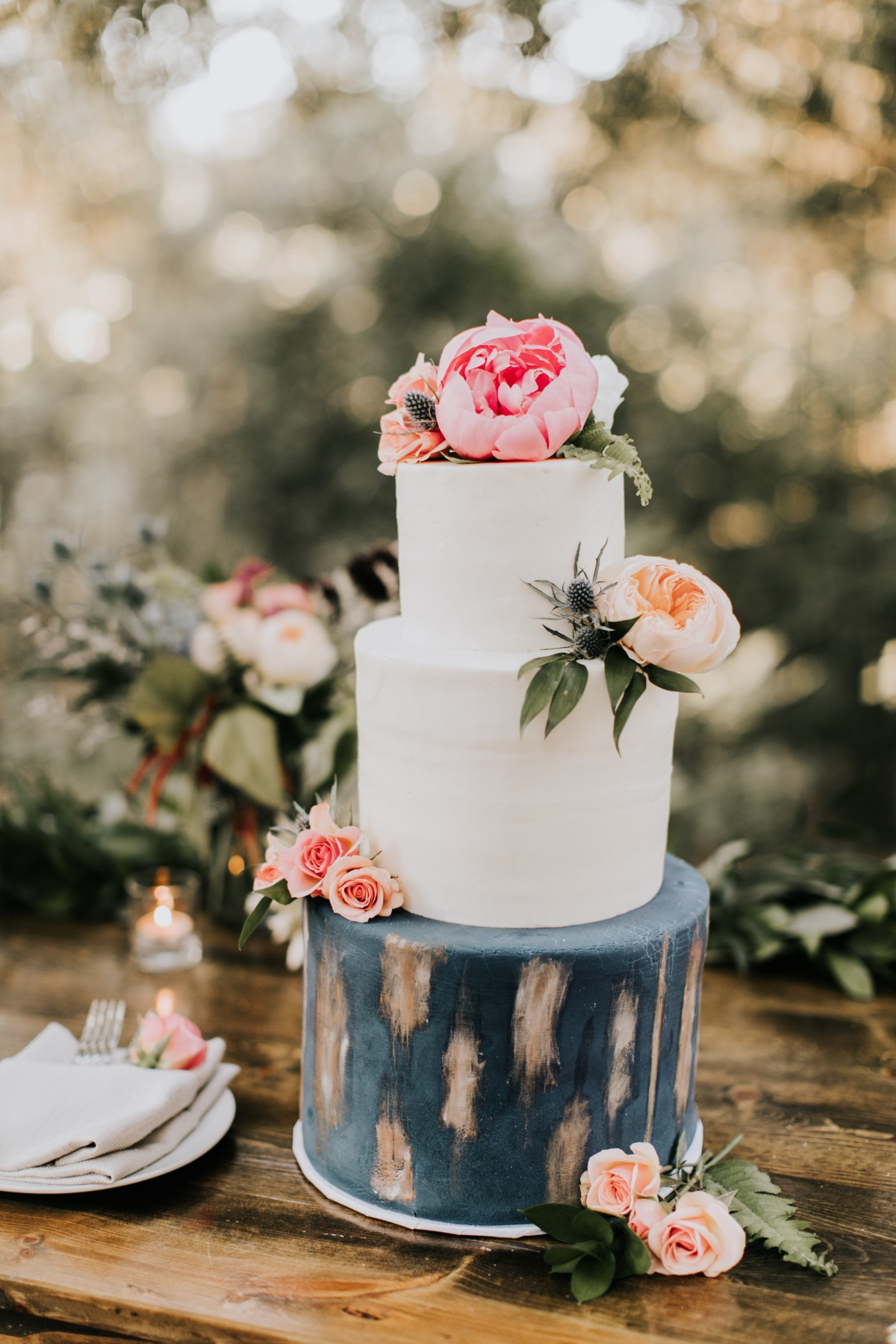 Modern navy, white, and gold wedding cake