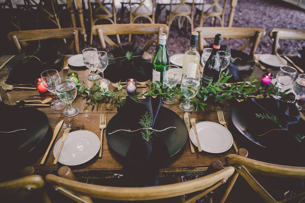 dramatic black and gold wedding place setting