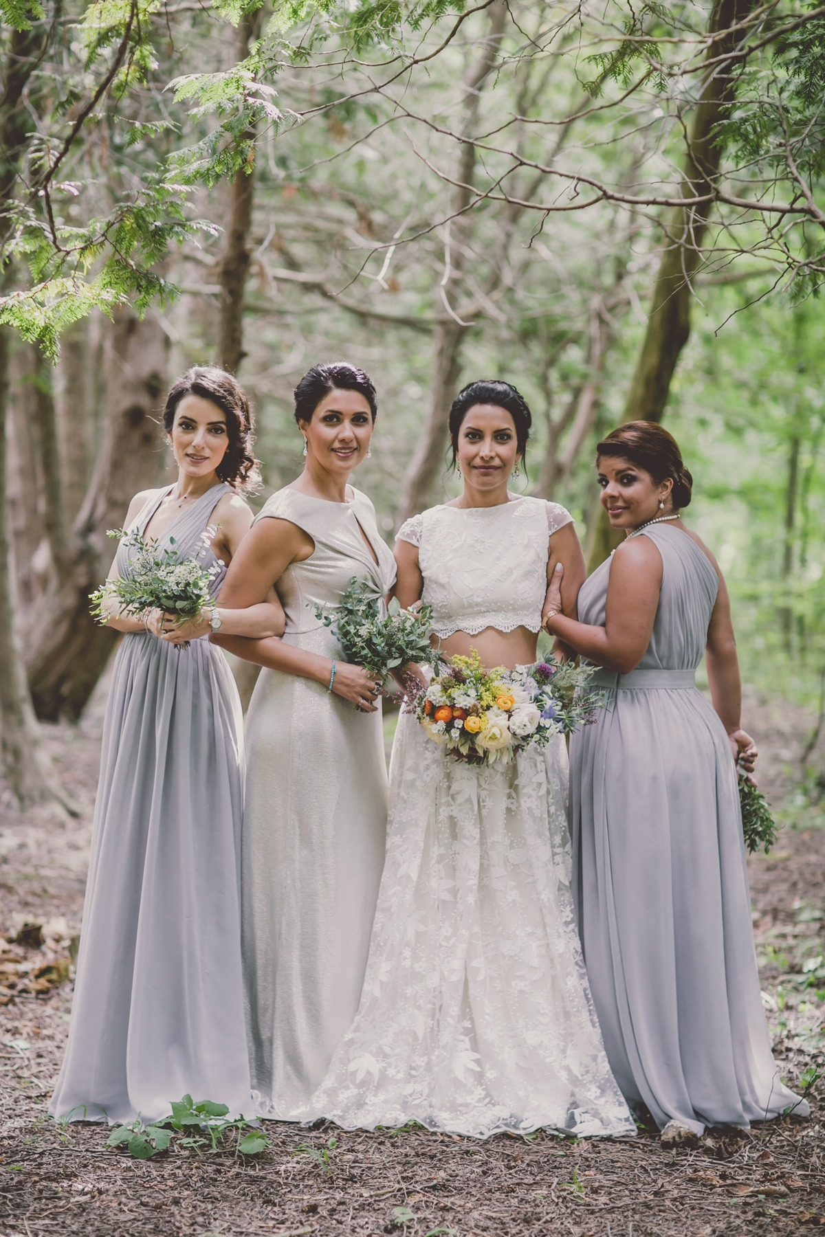 silver and grey bridesmaids and a two piece wedding dress
