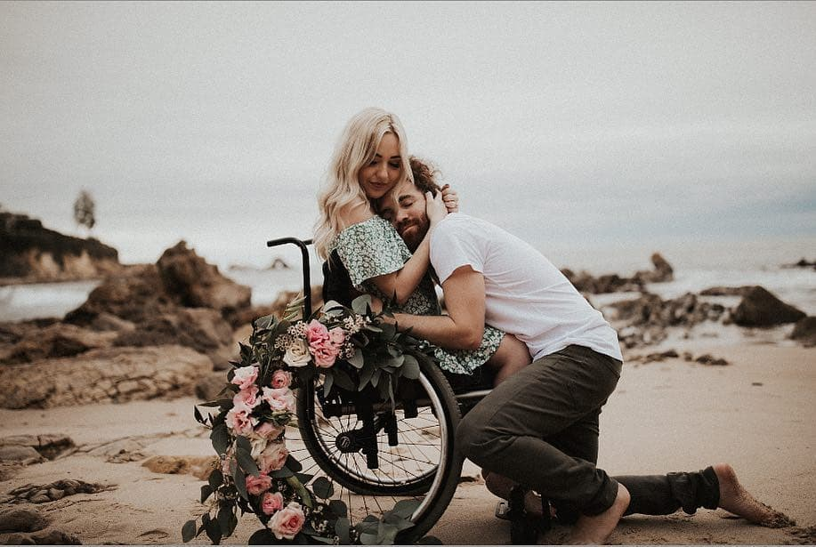 Engagement photos and hugs between a bride in a wheelchair and her groom