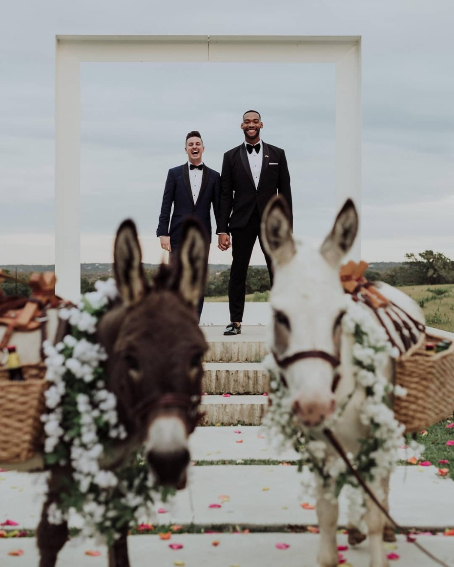 Grooms just married with beer burros