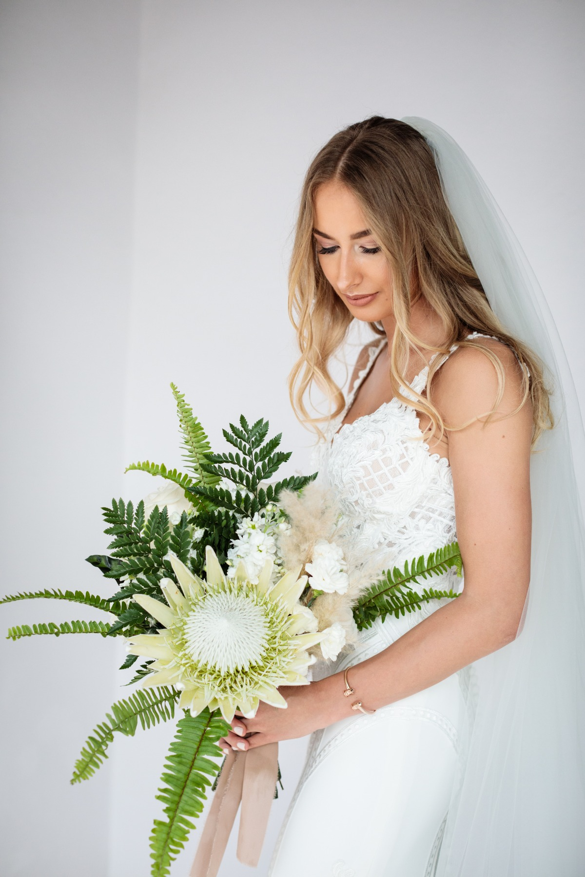 Giant white protea wedding bouquet