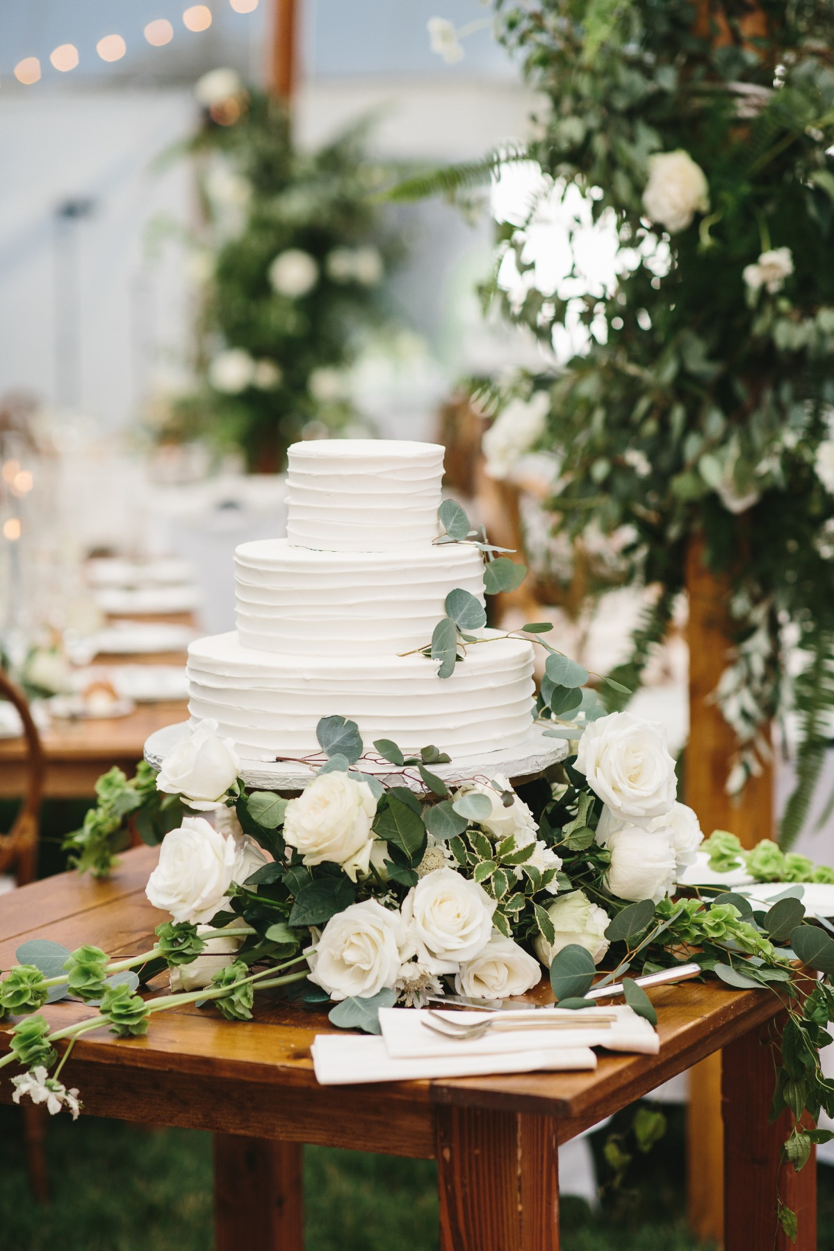 simple eucalyptus accented wedding cake