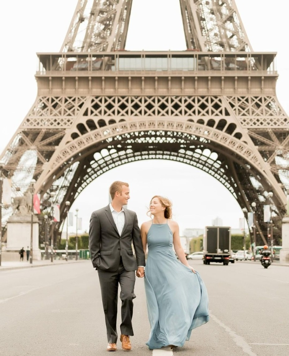 Couple strolling under the Eiffel Tower