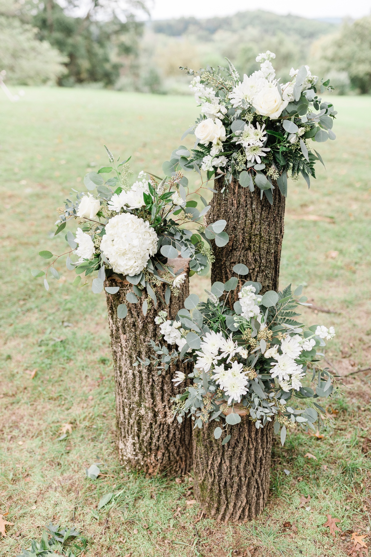 rustic stump and floral accents for wedding ceremony backdrop