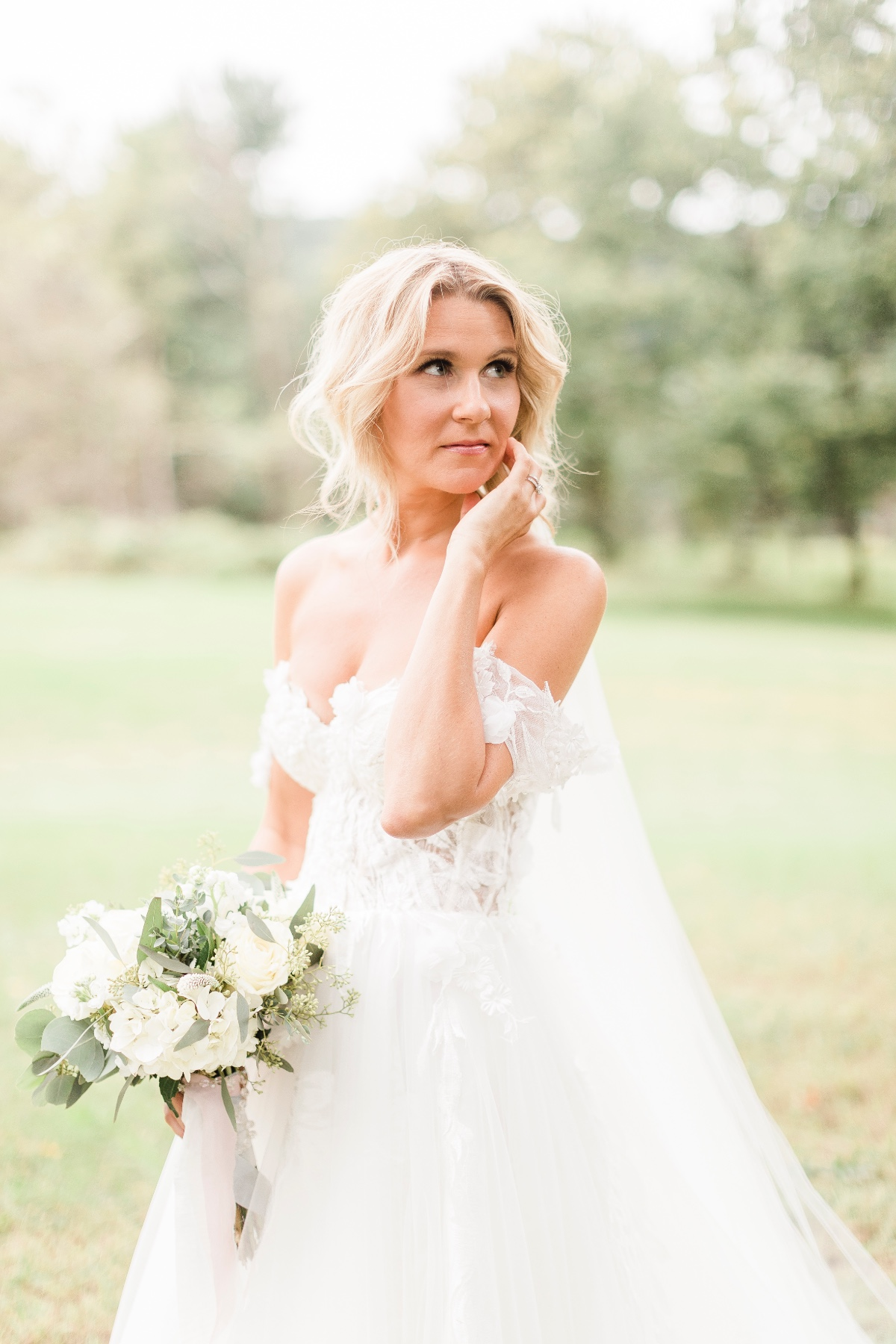 beautiful bride with off the shoulder dress