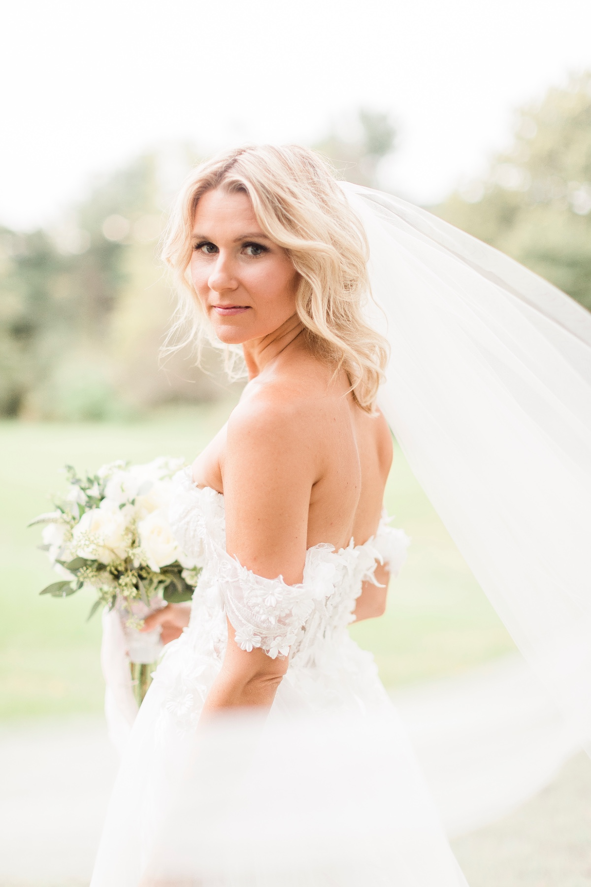 beach waves and off the shoulder wedding dress