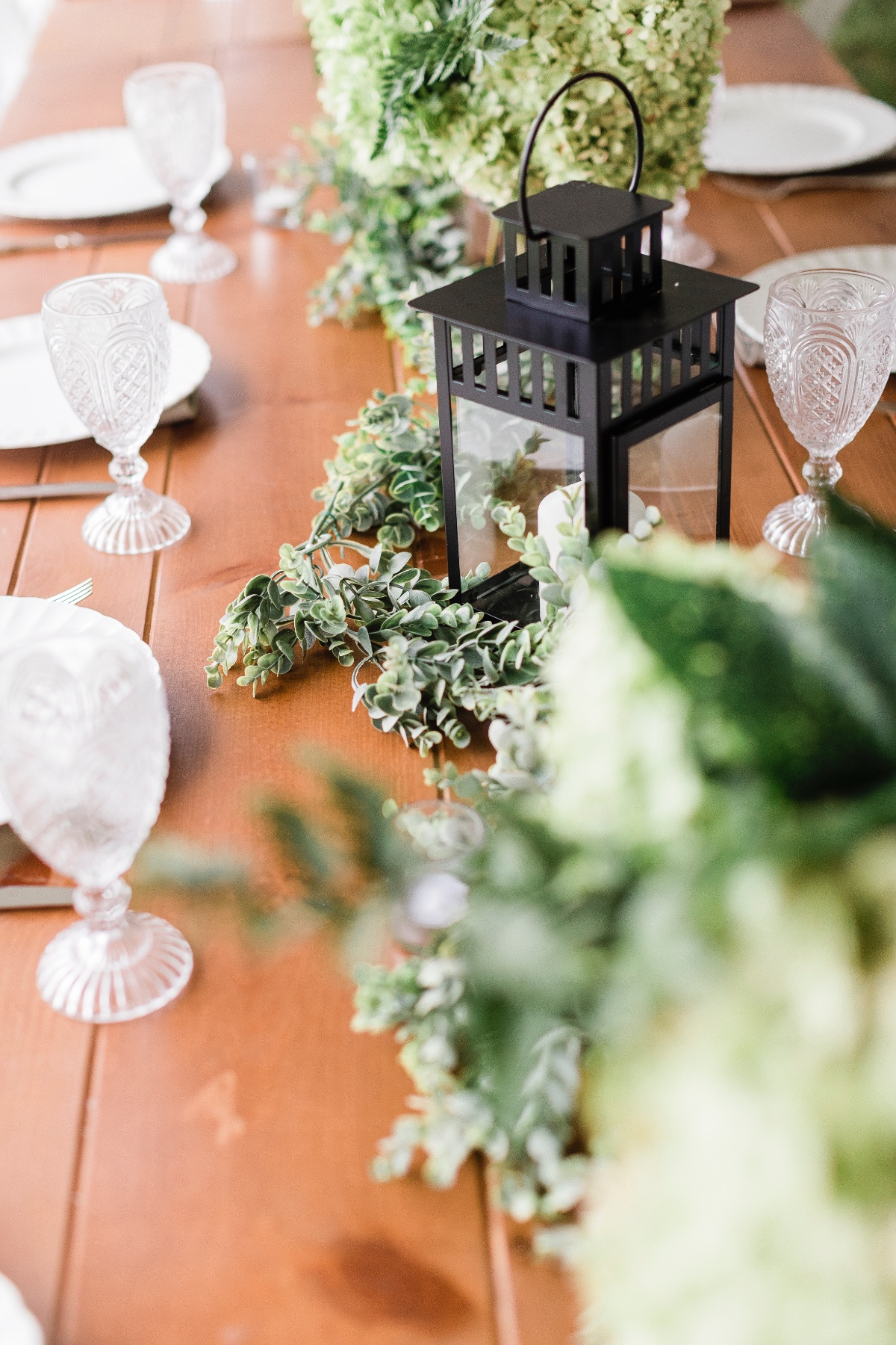 greenery and lantern wedding centerpiece