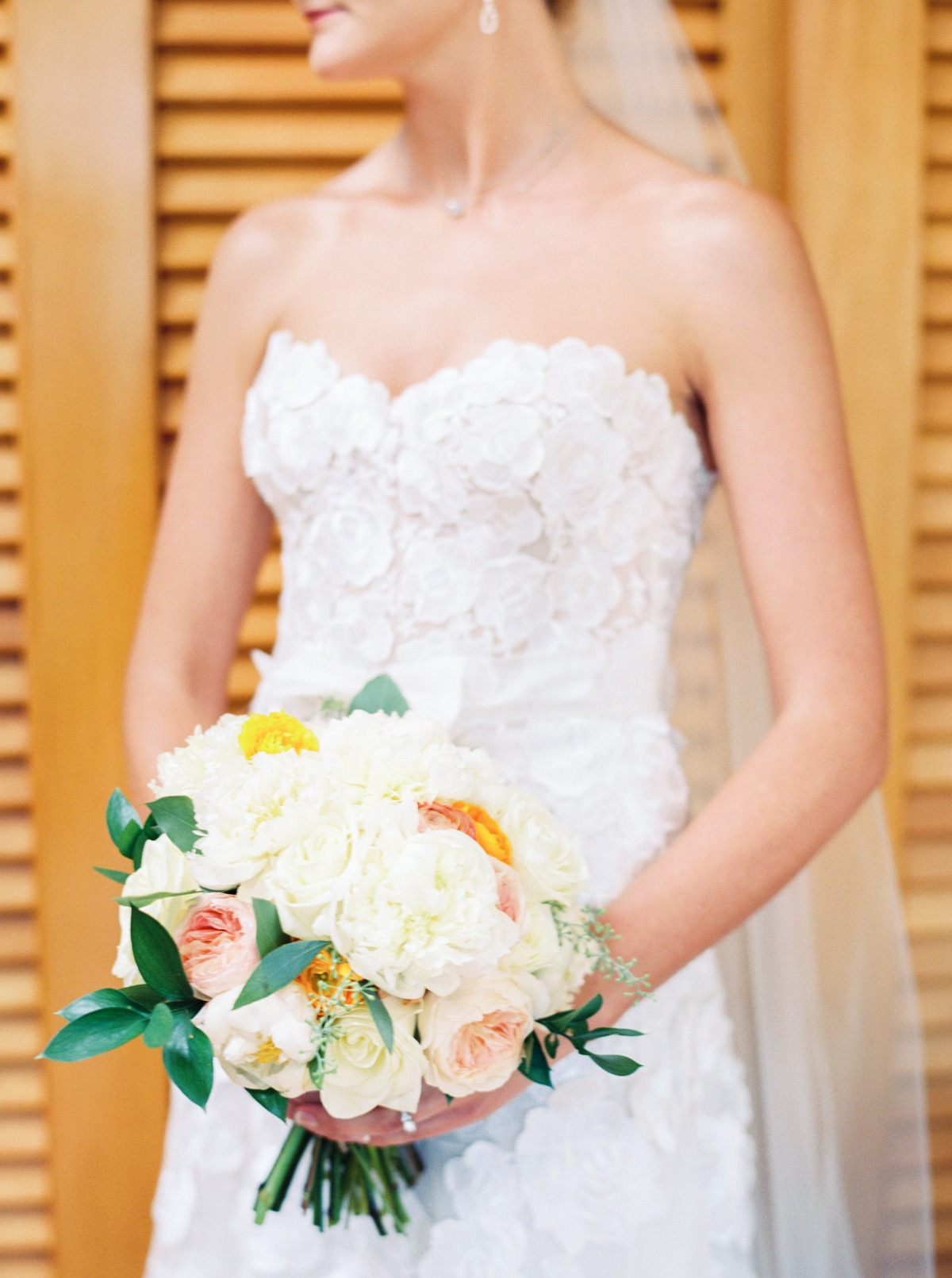 white yellow and peach wedding bouquet