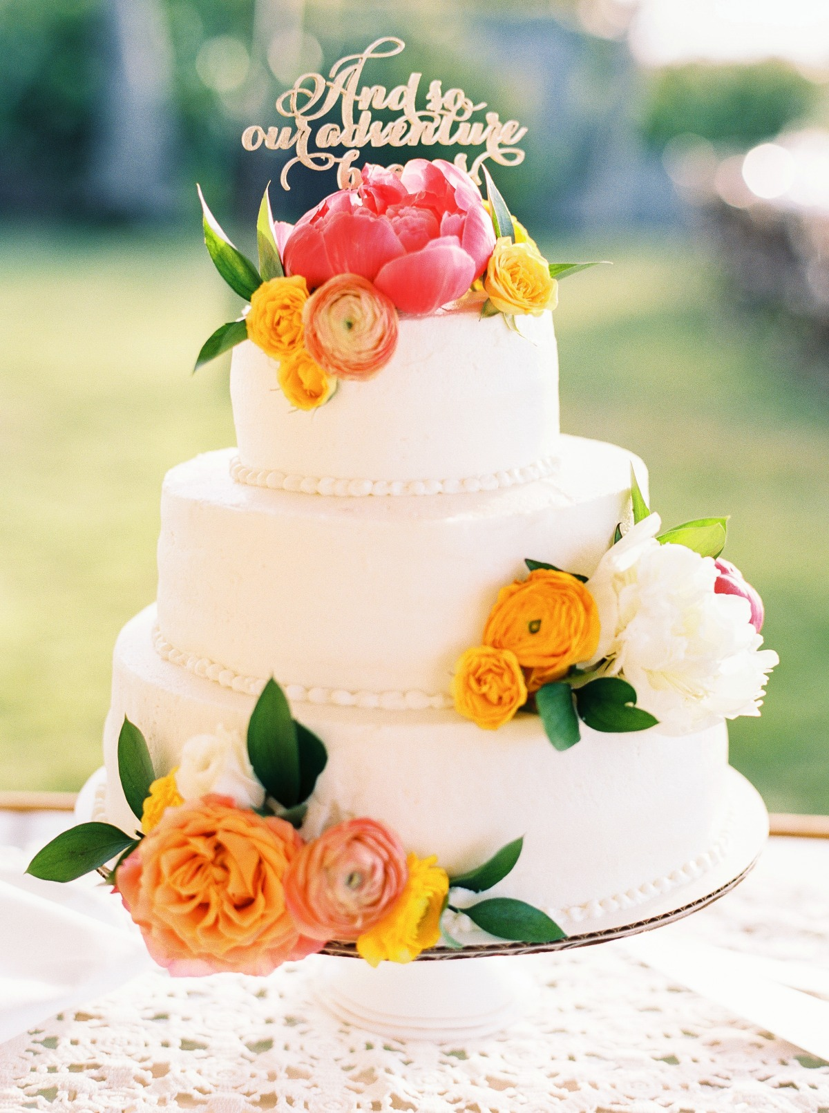 sunset inspired floral accented wedding cake