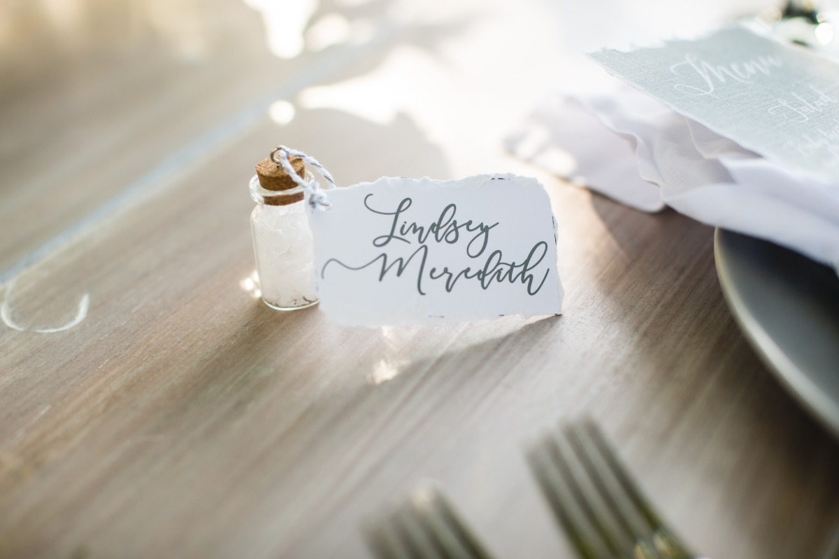 wedding escort card with corked salt bottle attached