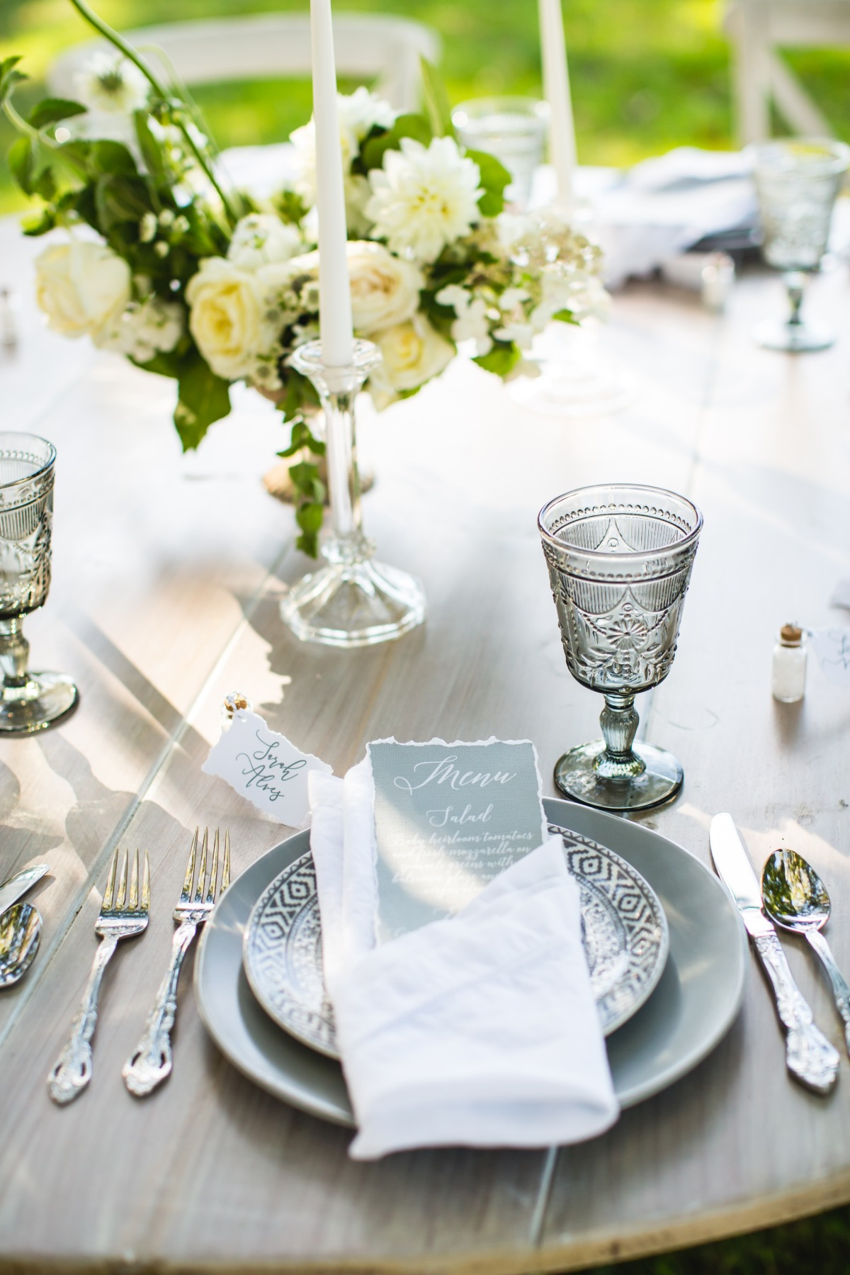 modern white and grey wedding place setting