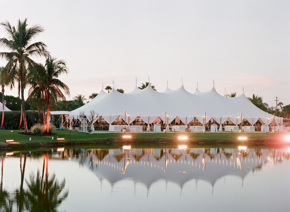 Sperry Tent reflection in the lagoon outdoor wedding