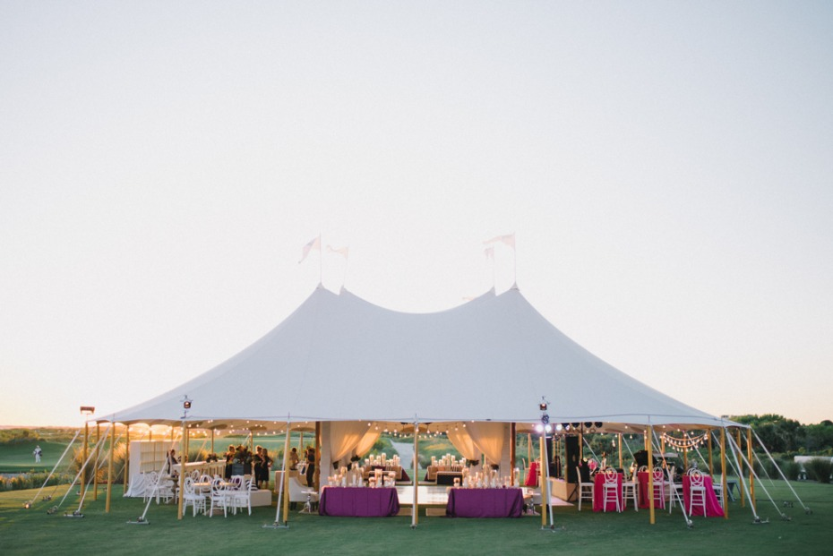 Outdoor wedding with tent and lights