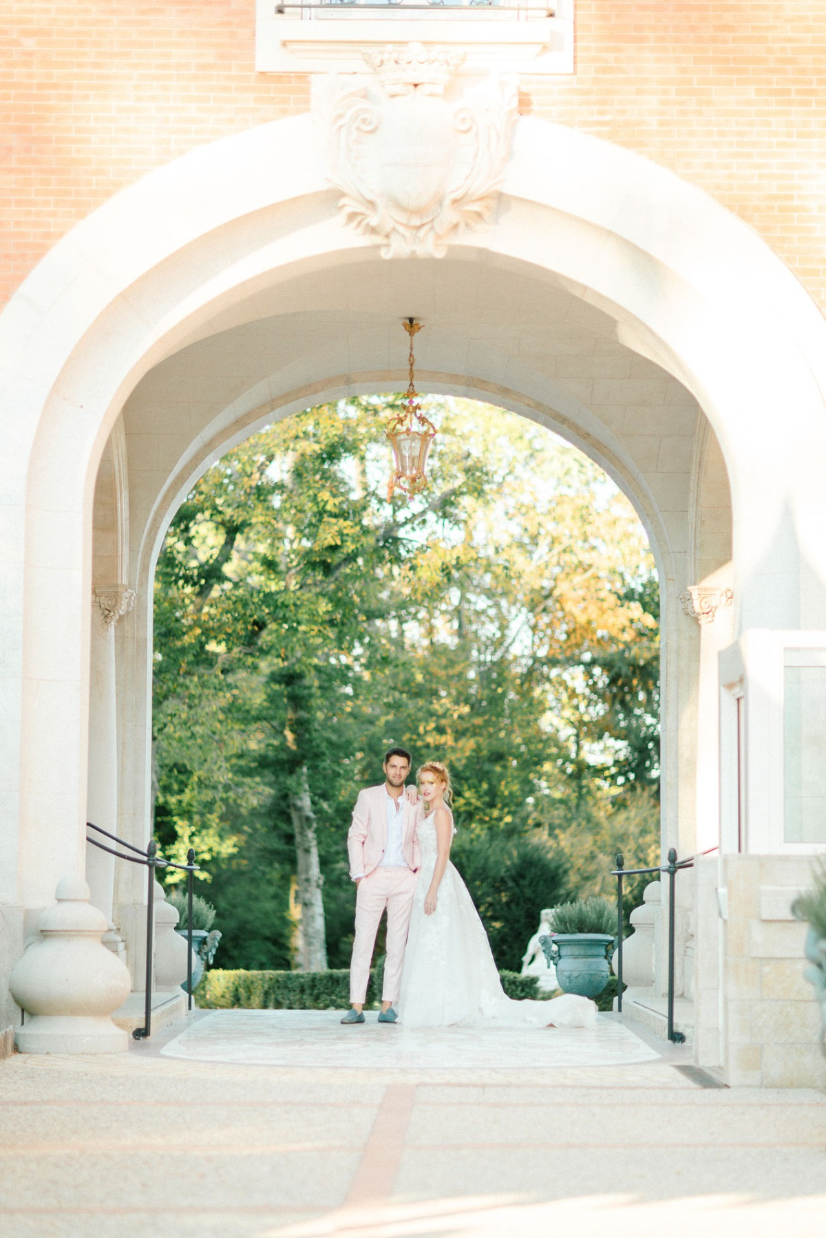 strong wedding couple in pink and gold