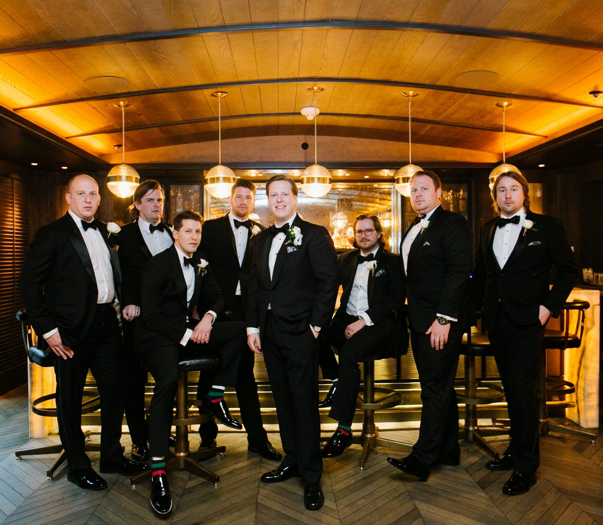 groom and groomsmen in classic tuxedos