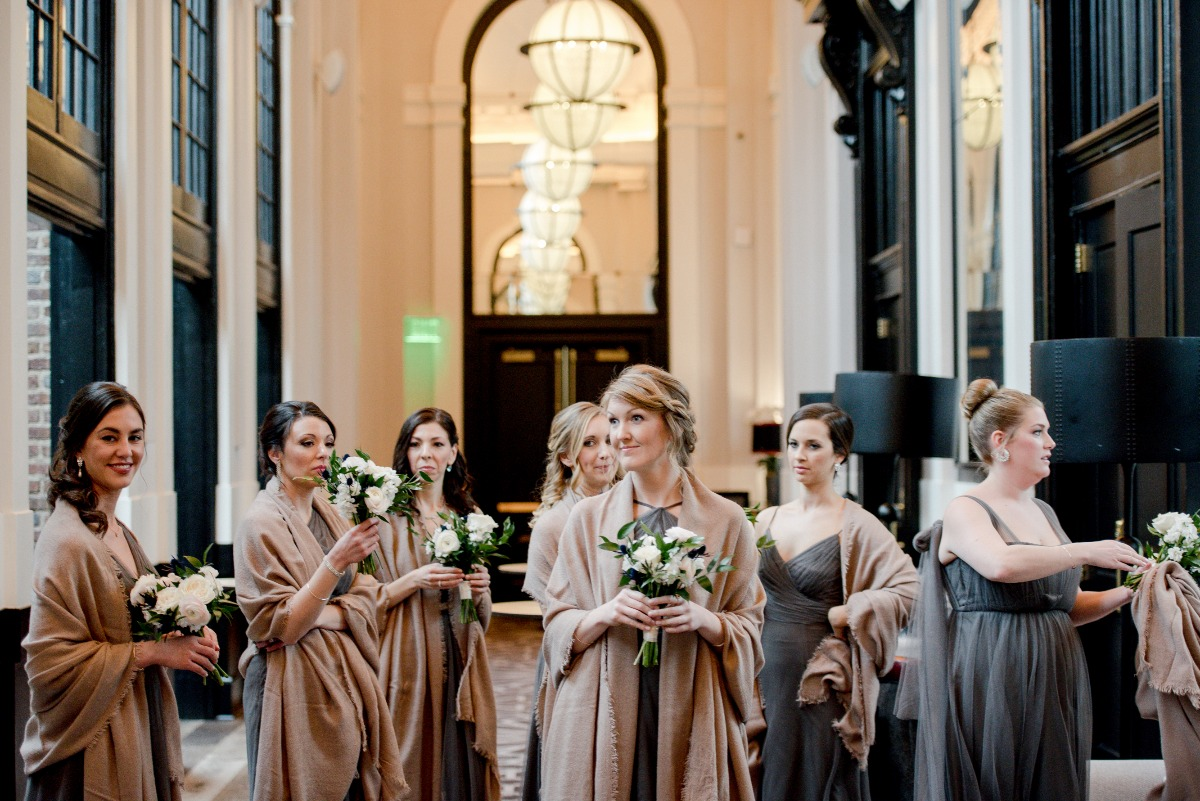 bridesmaids in grey dresses and camel colored shalls