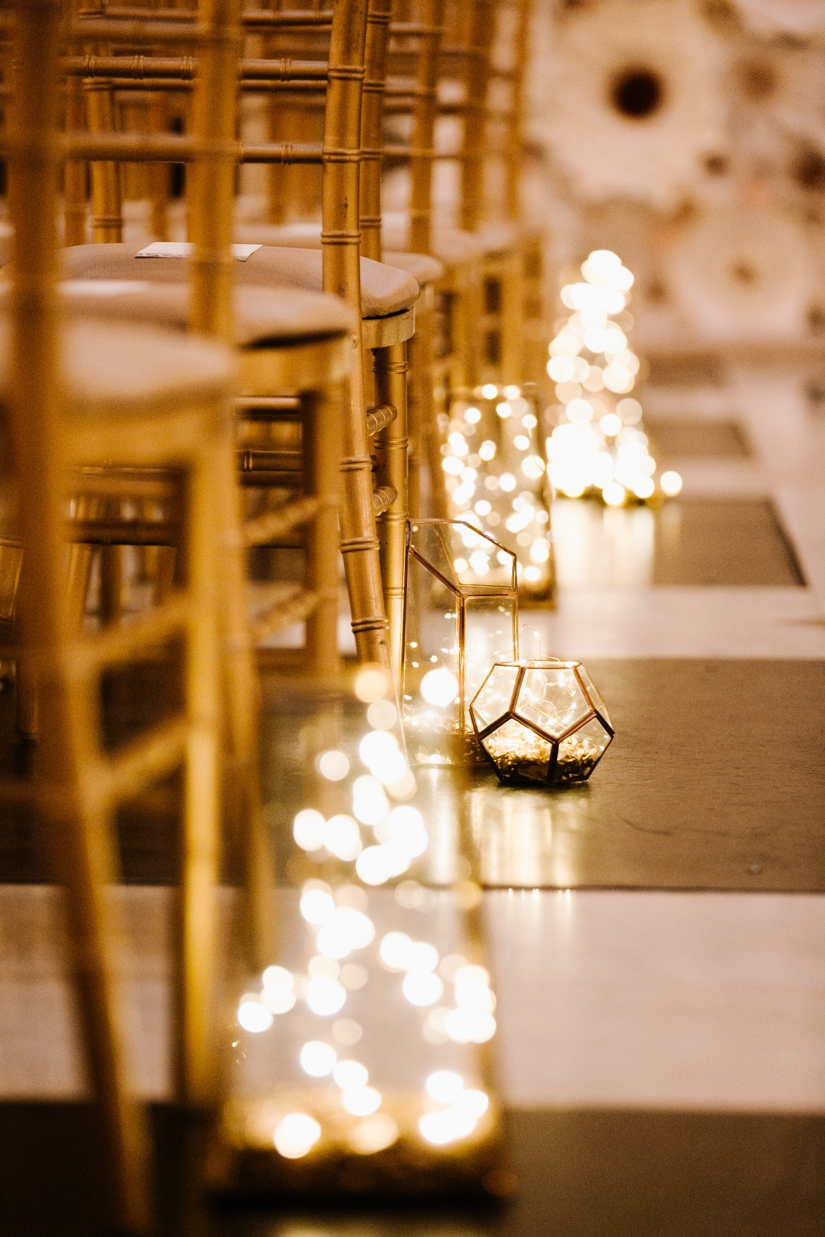 fairy light lit lantern wedding aisle