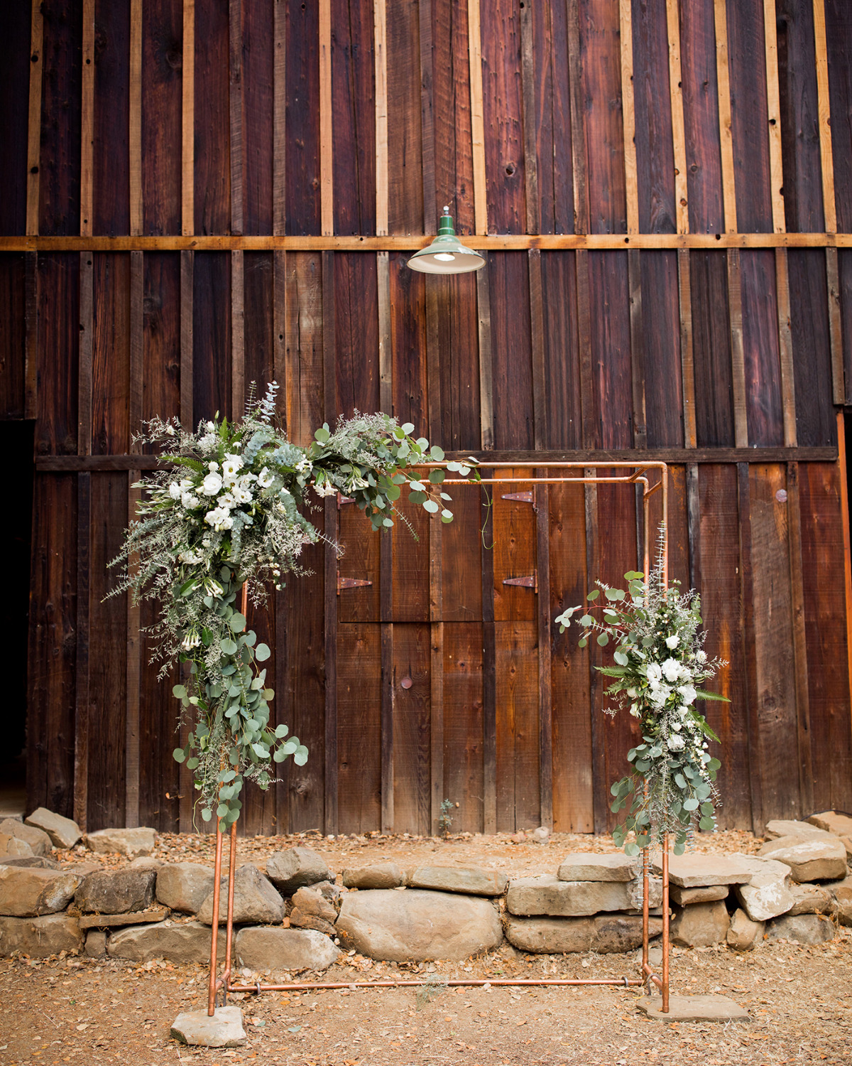 modern copper pipe and floral wedding arch