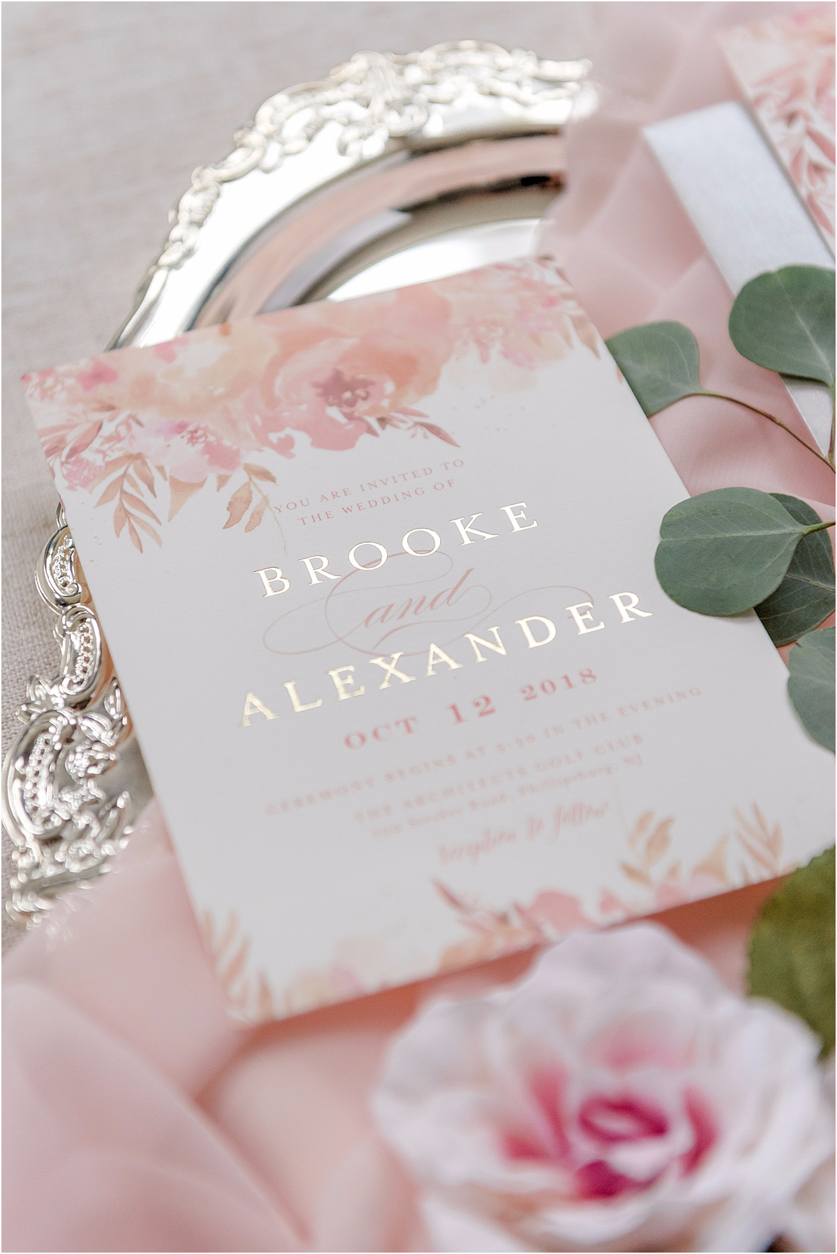 gold leaf wedding invitation with floral accents
