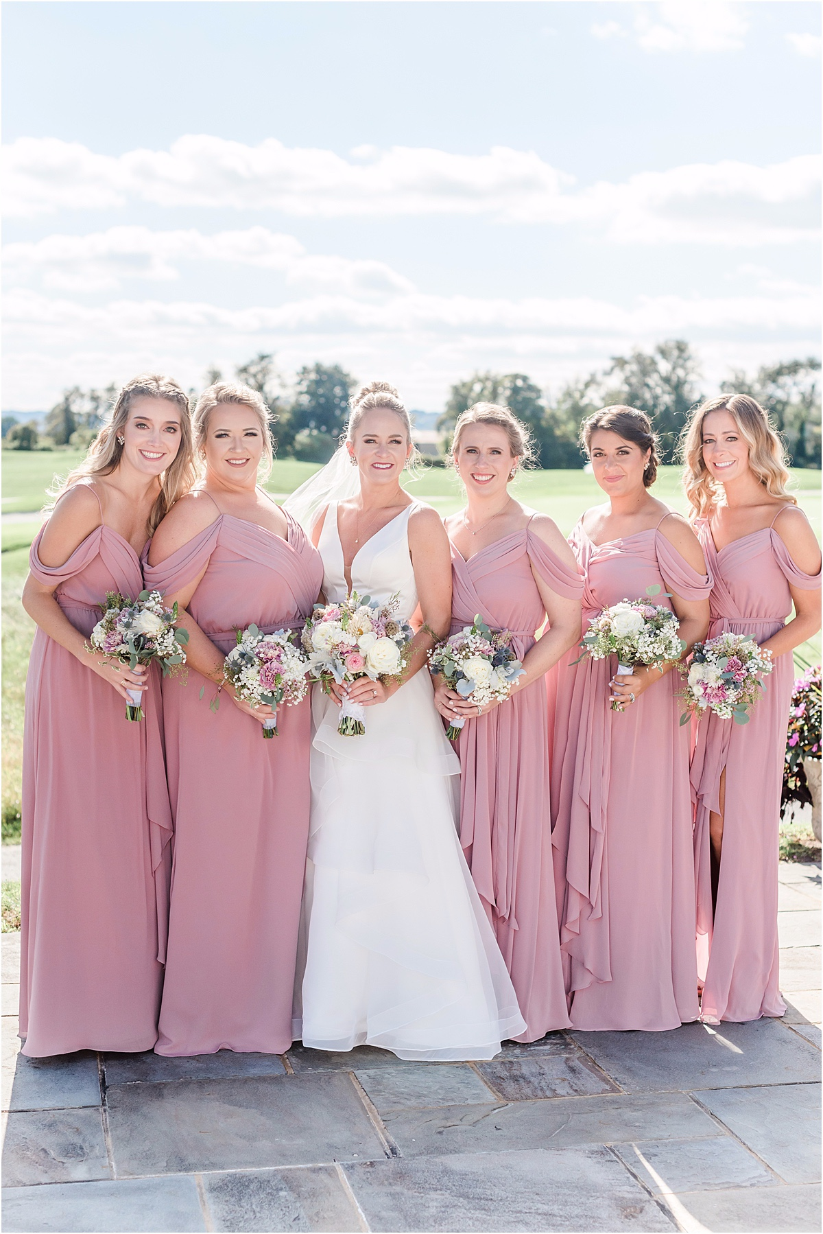 bridesmaids in floor length pink dresses