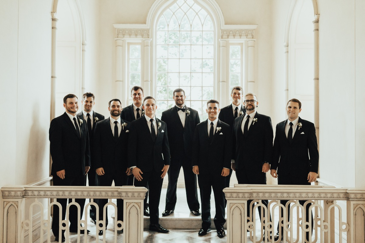 groom and groomsmen in black suits and ties