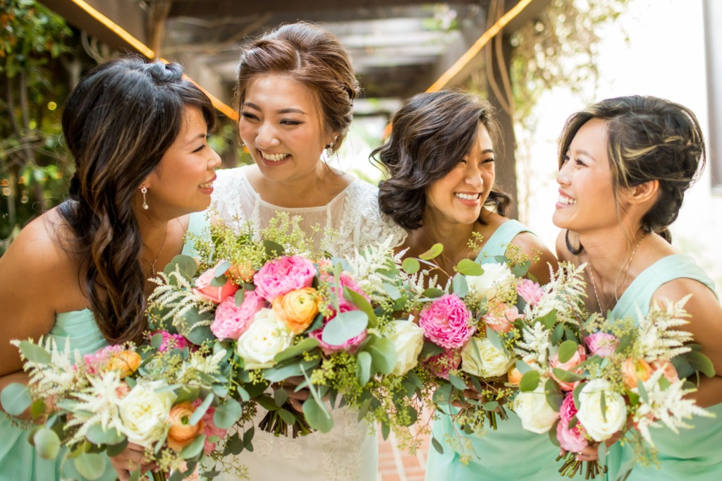 We love happy moments shared between a bride and her bridal party! And the bright beautiful colors in their bouquets compliment the