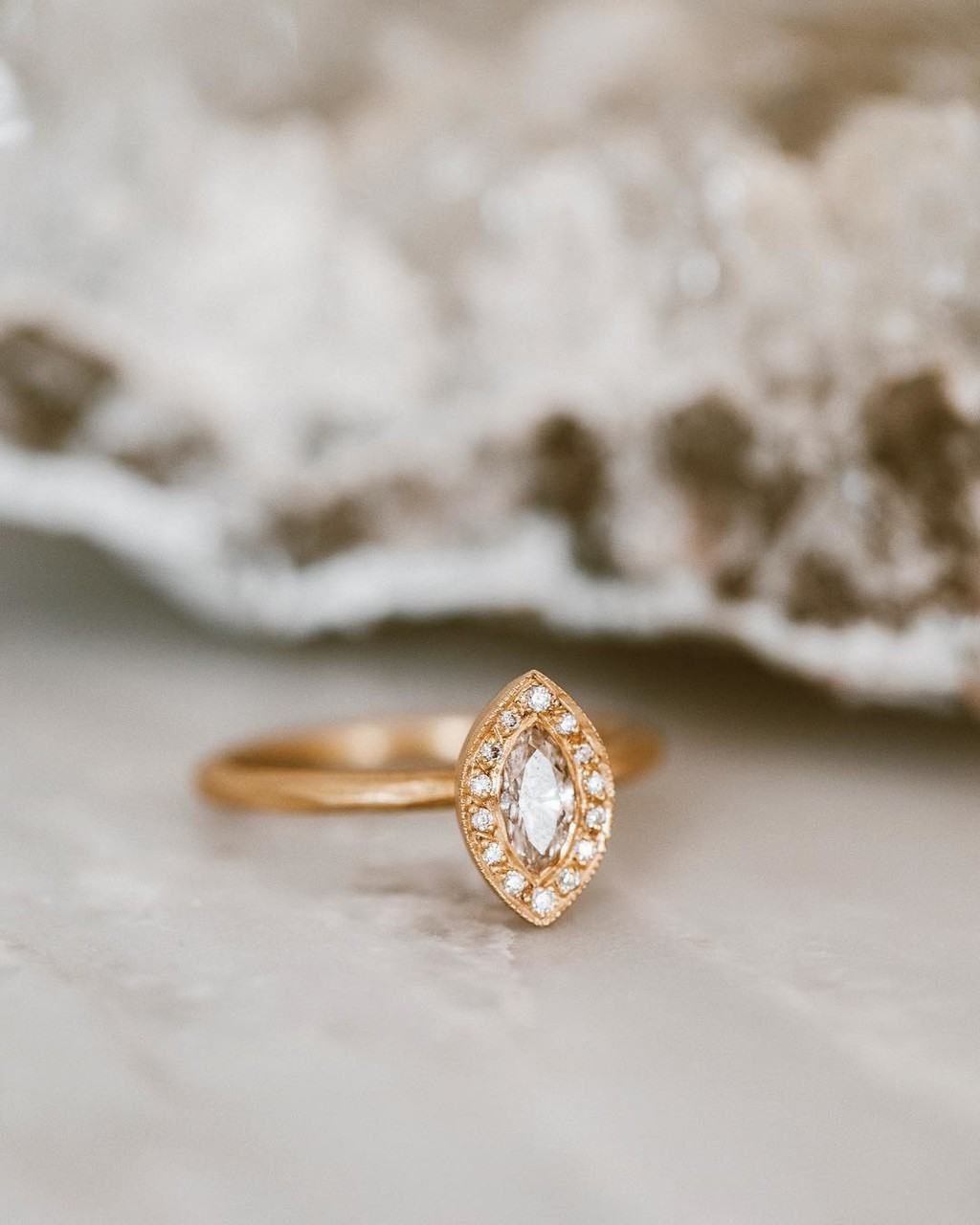 Marquise Monday featuring this dazzling rough diamond with a diamond halo.