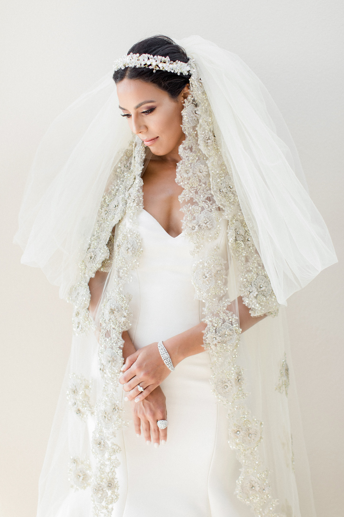 Monique Lhuillier wedding dress and dramatic wedding veil